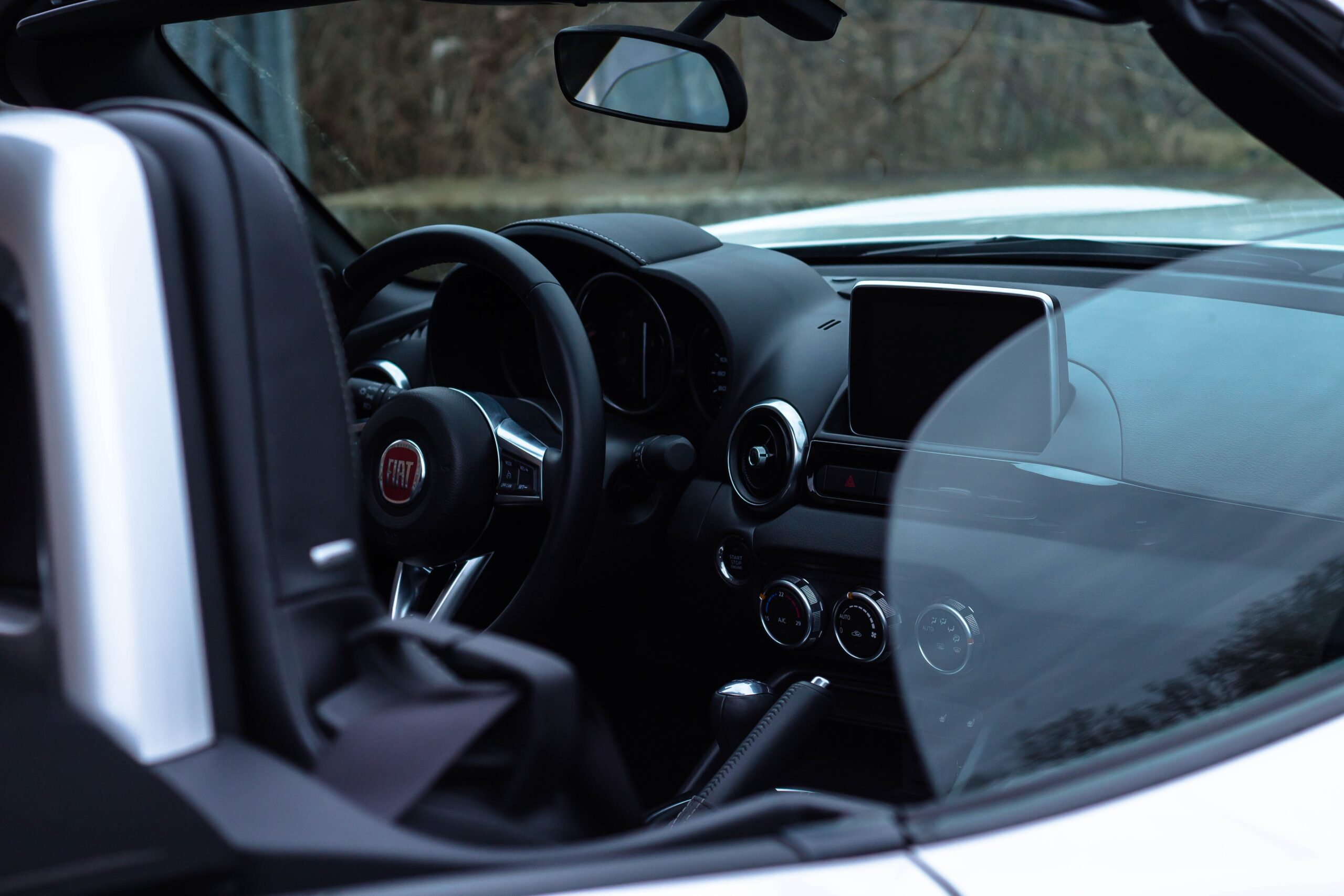 a shot of a car interior looking through the window.